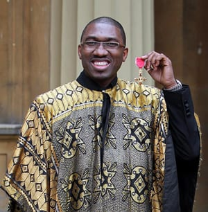 Kwame Kwei-Armah after his investiture as officer of the Most Excellent Order of the British Empire