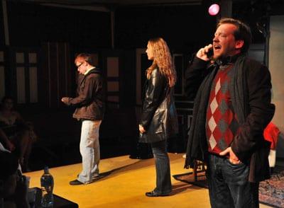 "Josh Meredith, Liz Pollack, and Ethan Treutle singing ""Unnoticed"" at [best imitation]. Photo Credit to Paul Gillis."