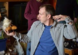 Ambassador Theater's actor Ivan Zizek (and puppet) prepare.